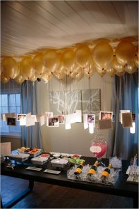 Photos floating below gold balloons