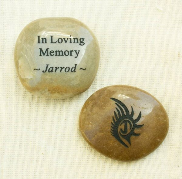 Custom stone engraved with loved one's tattoo
