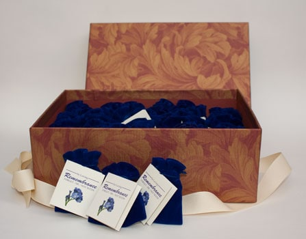 Box of forget me not seed packets in pouches