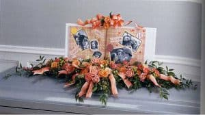 Casket flower arrangement with photos